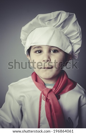 child dress funny chef, cooking utensils - stock photo