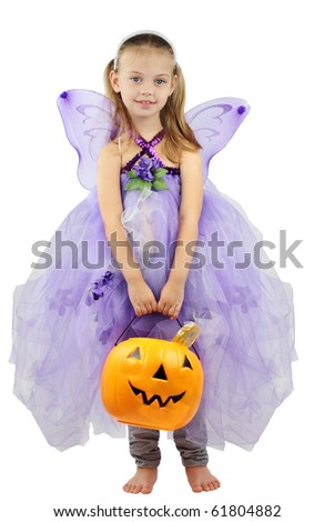 Child dressed as a fairy in a homemade costume for Halloween and holding a basket of candy. Isolated on a white background.