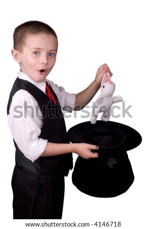 child dressed as a magician pulling a rabbit from his hat isolated over a white background - stock photo