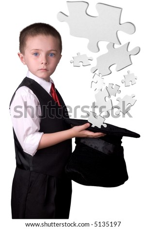 child dressed as a magician with hat full of puzzle pieces isolated over a white background - stock photo