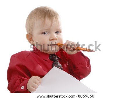 Child dressed in a red shirt and a tie  with a pencil and a paper in hands - stock photo