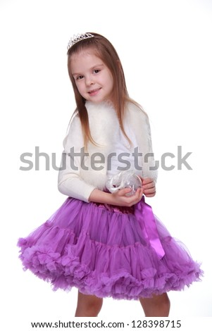 Child dressed in bright festive clothes on a white background