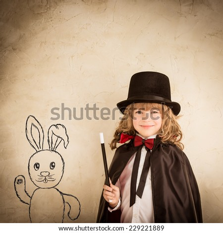 Child dressed in magician. Kid holding magic wand. Success concept - stock photo