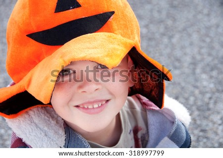 Child dressed up for Halloween - stock photo
