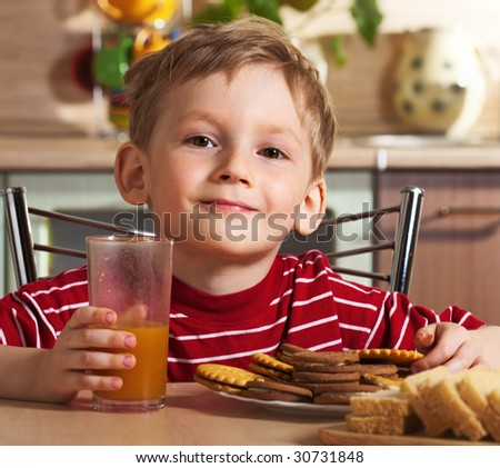 Child drinking orange juice - stock photo
