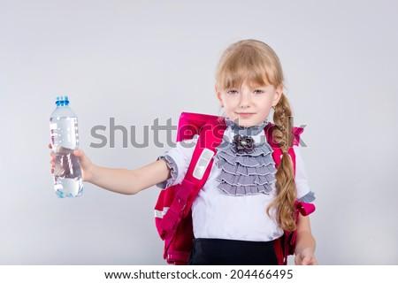 Child drinking water. - stock photo
