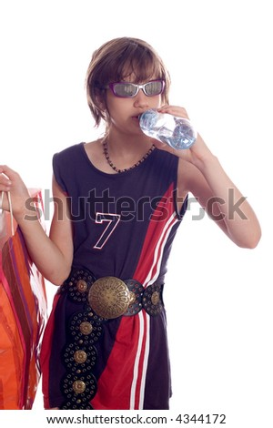 Child drinking water and holding bag after shopping - stock photo