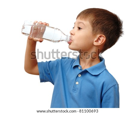 Child drinks water from bottle isolated on white background - stock photo