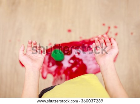 child dropped a jar of jam on the floor. shattered into pieces jar of jam on the floor, top view - stock photo
