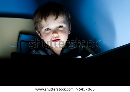 Child during reading book in his room