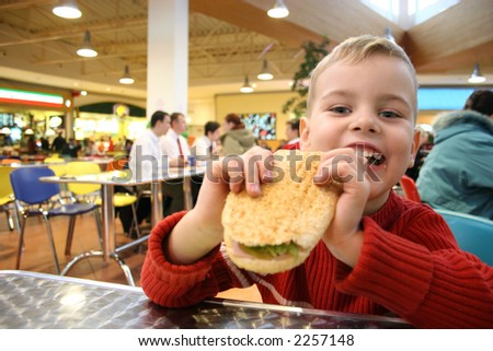 child eat burger - stock photo