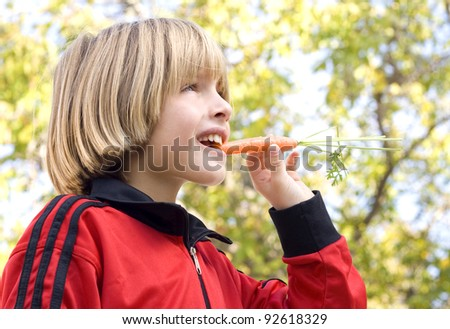 child eat carrots
