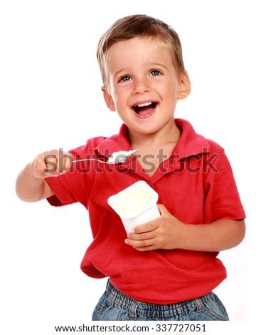 child eating a yoghurt - stock photo