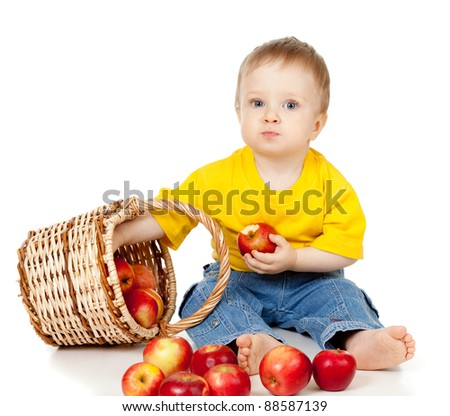Child eating apple and basket - stock photo