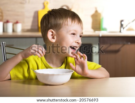 Child eating breakfast - stock photo