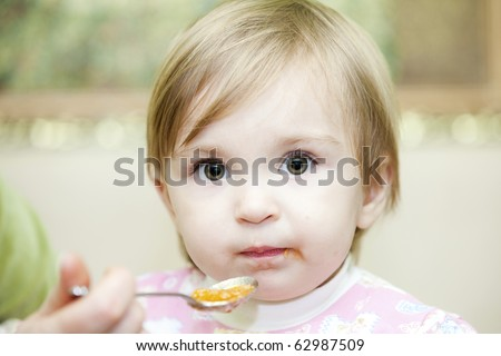 child eating messy food