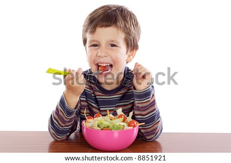 Child eating salad a over white background - stock photo