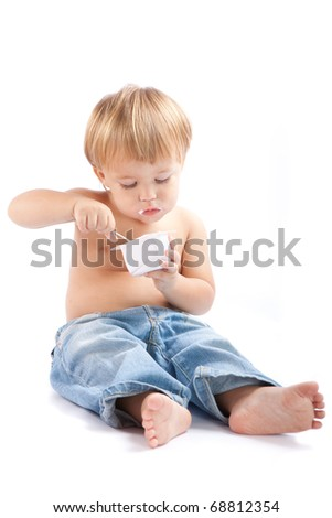 Child eats yoghurt - stock photo