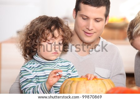 child emptying pumpkin - stock photo