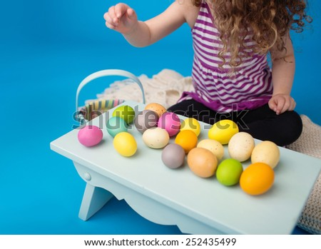 Child engaged in an Easter Activity with   Eggs  - stock photo