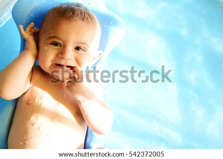 Child enjoying in the water