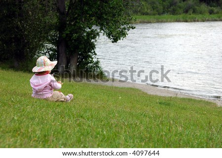 Child enjoying the lake view.