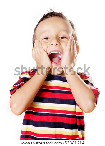 Child expressing surprise with his hands in his face