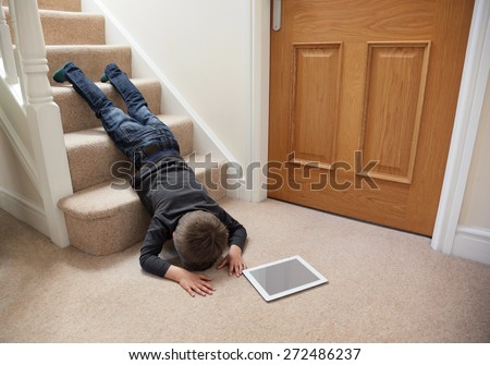 Child Falling Down Stairs Whilst Playing Stock Photo
