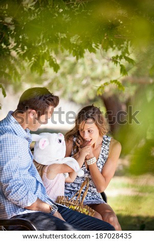 Child feeding her mom a chocolate Easter Bunny - stock photo