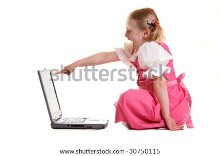 Child found something funny on the computer - stock photo