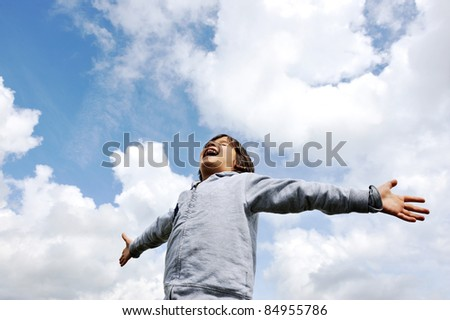 Child, freedom, breathing fresh air in nature - stock photo