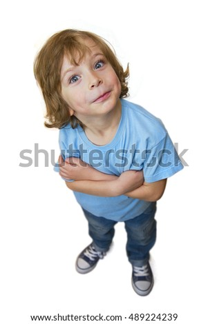 Child from above. Adorable little boy from above, standing full length, arms crossed, head sideways. Child looking slyly isolated on white