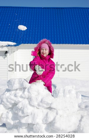child game of snowballs - stock photo