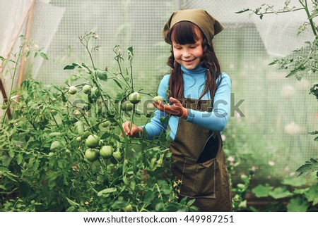 Child gardener. - stock photo