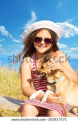 child gently embracing a dog - stock photo
