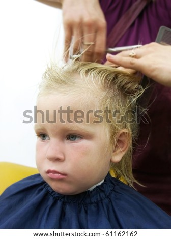 child getting haircut - stock photo