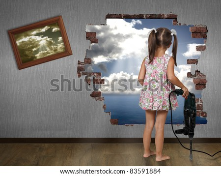 Child girl break the wall, discovery concept - stock photo
