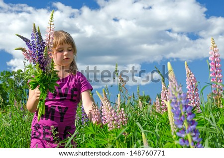 Child girl collects the flower - stock photo