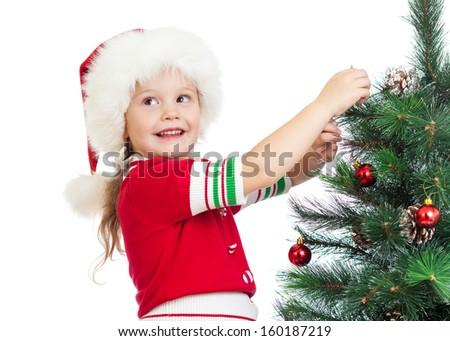 child girl decorating Christmas tree isolated on white - stock photo