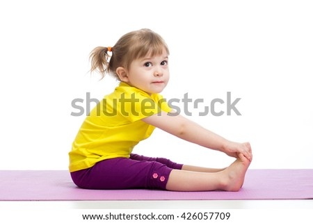 Child girl doing gymnastic exercises - stock photo