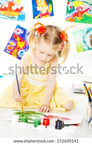 child girl drawing with brush. art education and creativity concept.