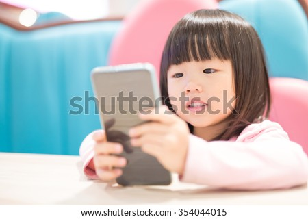 child girl happy look smart phone. asian child - stock photo
