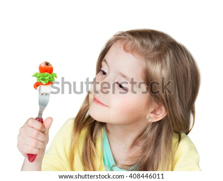 Child girl holding fork with greek salad vegetables isolated on white background. Healthy kid's nutrition concept. Vitamin food  lifestyle person. - stock photo
