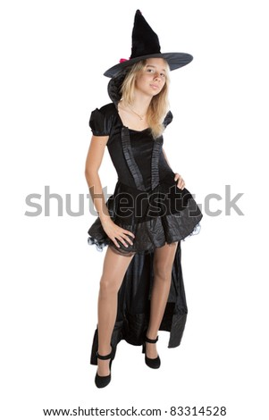 Child girl in Halloween witch - stock photo