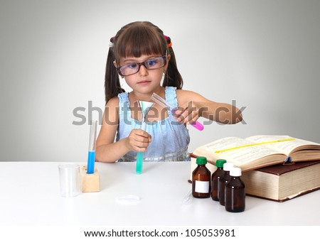 child girl making chemical test
