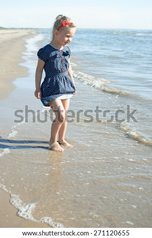 Child girl play sea water