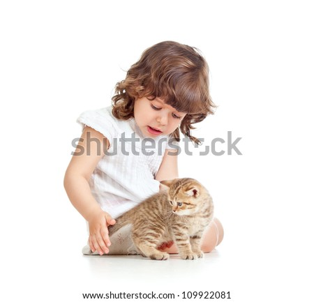 child girl playing and stroking cat kitten