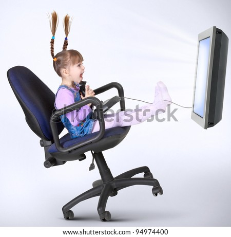child girl playing computer game with joystick - stock photo