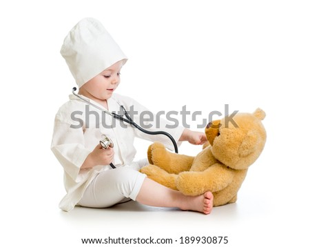 child girl playing doctor with toy - stock photo