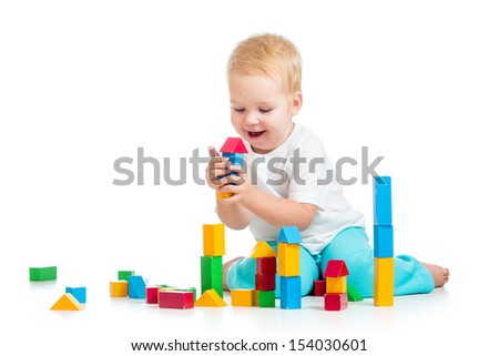 child girl playing with block toys over white background - stock photo